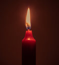 Fire candle burning red on black room Stock Images