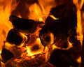 Fire close up burning and wood in fireplace Royalty Free Stock Photos