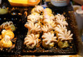 Fire cooking Burning for `Baby Octopus` in Takoyaki Japanese balls. Royalty Free Stock Photo