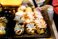 Fire cooking & x28;Burning& x29; for & x22;Baby Octopus& x22; in Takoyaki Japanese balls Royalty Free Stock Photo