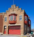 Fire department this is a winter picture of a building in maywood illinois the brick house was built in and is an example of Royalty Free Stock Photo