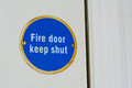 Fire door keep shut sign telling people to an entrance to stop a blaze spreading around a house by being stopped at the Royalty Free Stock Photography