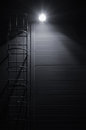 Fire emergency rescue access escape ladder stairway, roof maintenance stairs at night Royalty Free Stock Photo