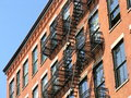 Fire escape soho new york city a red brick building in the cast iron historic district Stock Images