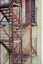 Fire escape stairs on manufacturing building exterior Stock Photo