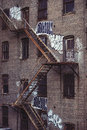 Fire escape stairs on an old building exterior in New York, Manhattan Royalty Free Stock Photo