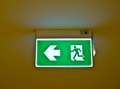 Fire exit sign in building Stock Photos