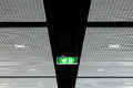 Fire exit sign on ceiling with light Stock Photos