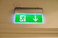 Fire exit sign emergency Stock Photography