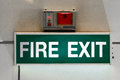 Fire exit sign on green background Stock Images