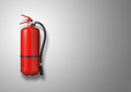 Fire extinguisher on gray background Stock Image