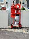 Fire extinguisher trolley mobile red with wheels and handles Royalty Free Stock Photography