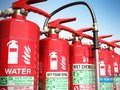 Fire extinguishers isolated on blue background Various types of Royalty Free Stock Photo