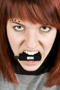 Fire-eyed girl biting memory stick Royalty Free Stock Photo