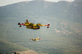 Fire fighter plane over the mountains Stock Images