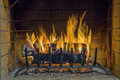 Fire in fireplace. Closeup of firewood burning in fire. Royalty Free Stock Photo