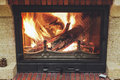 Fire in fireplace. Logs burning in beautiful modern fireplace Royalty Free Stock Photo