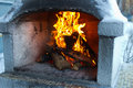 Fire in the furnace burning firewood brick Stock Photography