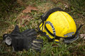 Fire helmet and fire gloves a firefighter s laying on the ground after a Stock Photos