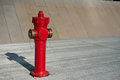 Fire hydrant in a car park Royalty Free Stock Photos