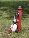 Fire hydrant red with hose Stock Images