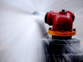 Fire hydrant spraying high pressure water Stock Photography
