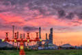 Fire hydrants and oil refinery plant. Royalty Free Stock Photo