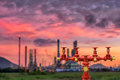 Fire hydrants and oil refinery plant blur background., Industrial object. Royalty Free Stock Photo