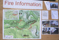 Fire information public notice board with photographs and map of the big meadows wild caused by a lightning strike in the rocky Royalty Free Stock Photos