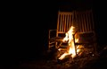 Fire kindling that is burning on a pair of old rocking chairs Stock Images