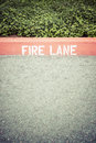 Fire lane curb with painted on Stock Photos