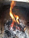 Fire pit and coals in Royalty Free Stock Photo