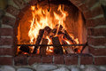 Fire place with burning flame Stock Photography