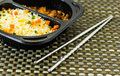 Fire rice with chopsticks in a black lunch box Royalty Free Stock Photography