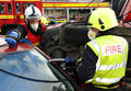 Fire service jaws of life cutting at a car crash Royalty Free Stock Photo