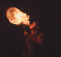 Fire show artist breathe fire in the dark Royalty Free Stock Photos