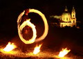 Fire show with church behind Stock Photography