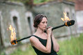 Fire show girl with flaming torches Royalty Free Stock Photo
