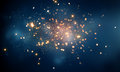 Fire sparkles in dark blue bokeh background Royalty Free Stock Photo
