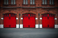 Fire Station with red doors Royalty Free Stock Photo