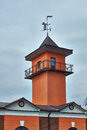 Fire station with tower and weather vane Stock Photos