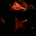 Fire to burn in stoves firewoods and on a black background warm heating Royalty Free Stock Photo
