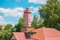 Fire tower old and the roofs of the old town Royalty Free Stock Photo