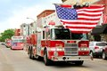 Fire Trucks with American Flags at Small Town Parade Royalty Free Stock Photo