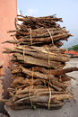 Fire wood bundled by rural villager neat bundles of dry collected stacked up a indian in the foothills of the himalayas Stock Image