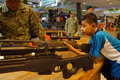 Firearms exhibition school students recognize the military owned in an in the city of solo central java indonesia Royalty Free Stock Image