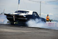 Firebird napierville dragway canada june rear side view of pontiac drag car during burnout at head up challenge event Royalty Free Stock Images