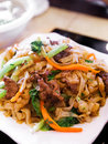Fired chinese rice noodle with meat and vegetables Stock Photography