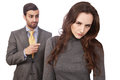 Fired at work young women with angry boss standing in the background Stock Image