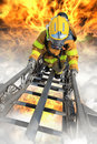 Firefighter ascends upon a one hundred foot ladder Royalty Free Stock Photos